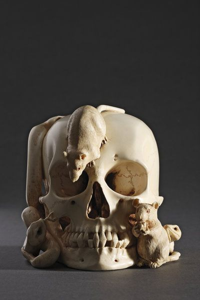 A Japanese carved Ivory Skull, Snake, and Rats Okimono, Circa 1900    The dead are houses for other things.