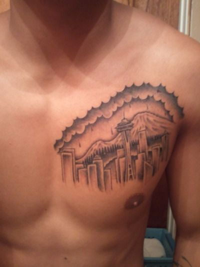 Seattle tattoo right over the heart. Um, I think that's a little too much dedication to the Emerald City