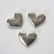 Small pewter wishing hearts with engraved words