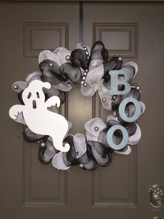This Halloween wreath is perfect for welcoming trick or treaters or party guests! Black and white deco mesh make up the base of this very full wreath. A White ghost, silver BOO and cute ghost ribbons make up all the accessories on this wreath that will make it stand apart from any others! Lights can be added to make it a light-up wreath if you choose. Please send us a message if this is something you would like. There will be an additional charge.