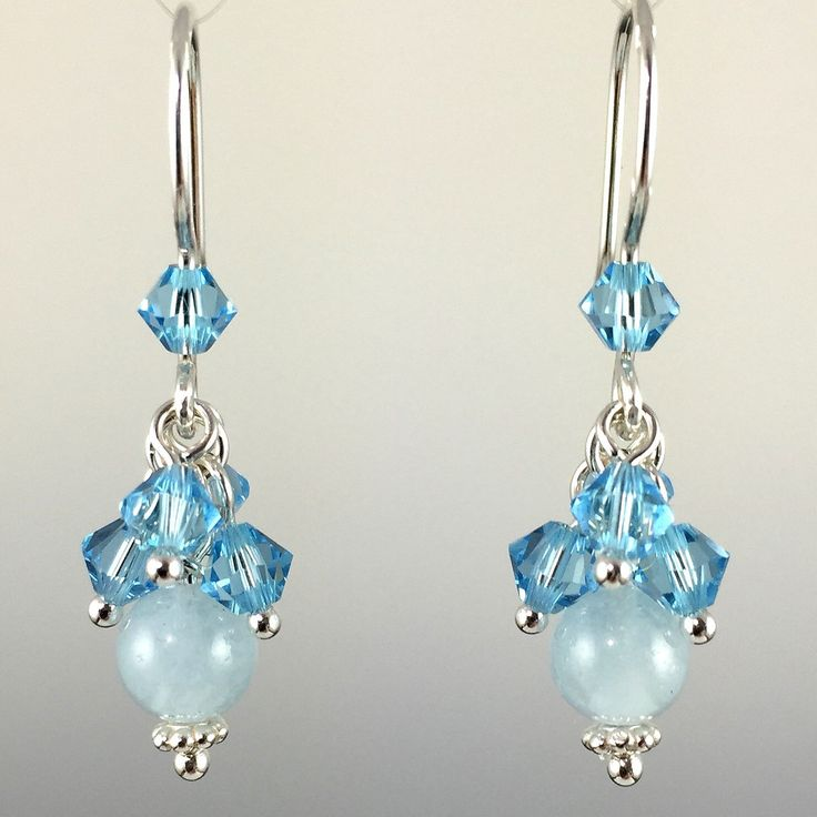 - Natural Aquamarine Gemstones at the bottom - Adorned with Swarovski crystals and/or Swarovski crystal pearls on top - Hand formed .925 sterling silver ear wires with rubber earring backers - All met