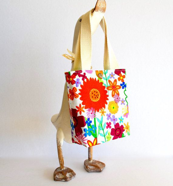 Colourful bag for heaps of summer fun! Check out RobynFayeDesigns at https://www.etsy.com/au/sho... for lots of beautiful purses and cross body bags!  Little girls purse makeforgood flower bag by RobynFayeDesigns