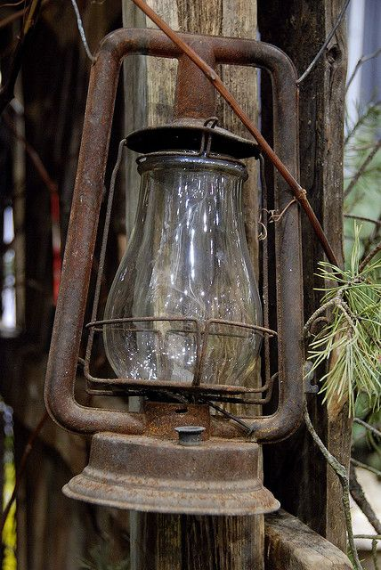 rusty & rustic lantern...add a little pine needles, holly and a red ribbon ..a nice holiday piece...