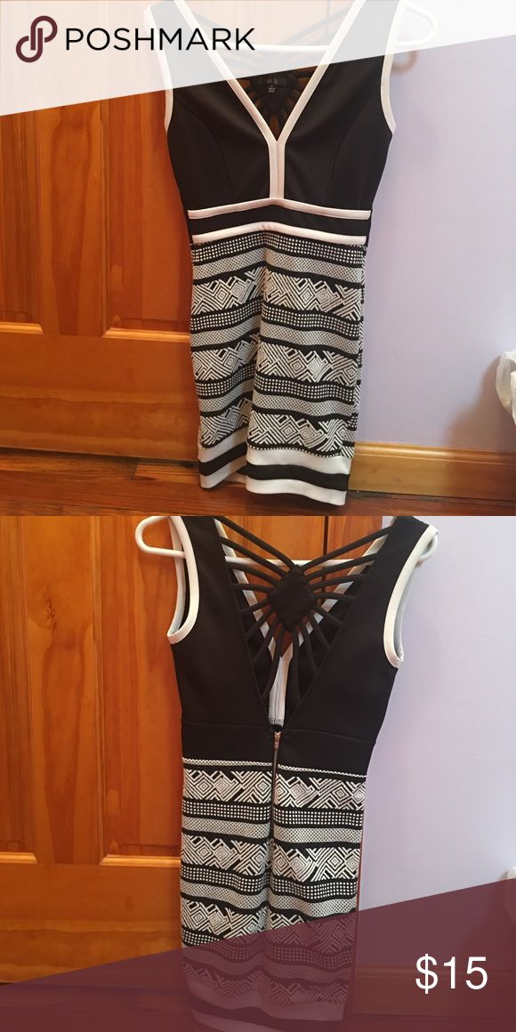 Black and White Mini Dress Black and white patterned mini dress. In new condition. Dresses Mini