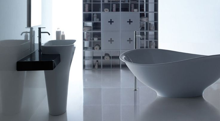 Washbasin  with shelf and Pietraluce® bath thub ---- Lavabo monolite con mensola e vasca in Pietraluce®