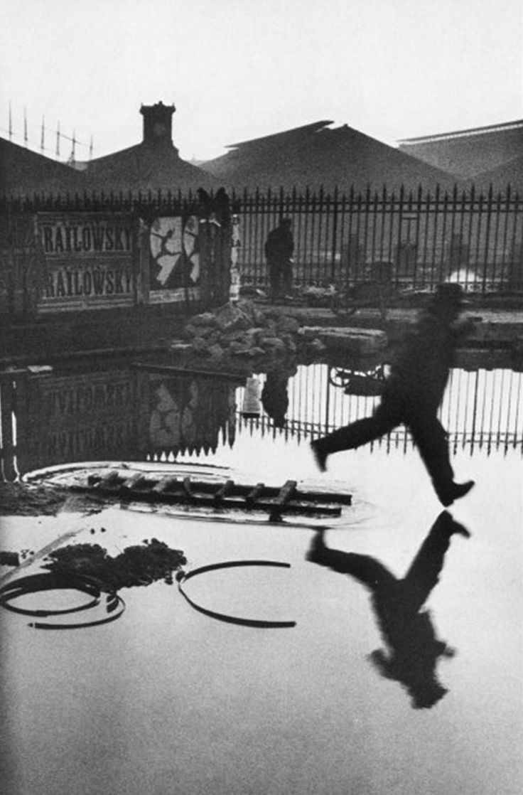 "The Decisive Moment - ""Behind the Gare Saint Lazare"" 1932. Taken by Henri Cartier-Bresson, maybe my favorite photographer."