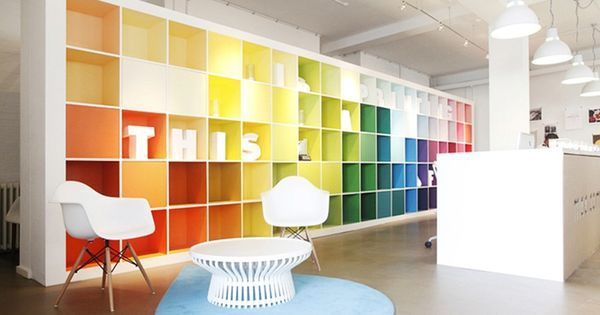 Decorate a large wall shelf with vibrant colours and finish it off with a white border.