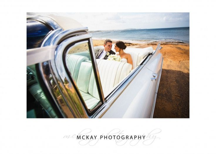 Cassie & Clint in the cadillac at Long Reef beach  #caddy #cadillac #wedding #longreef #mckayphotography