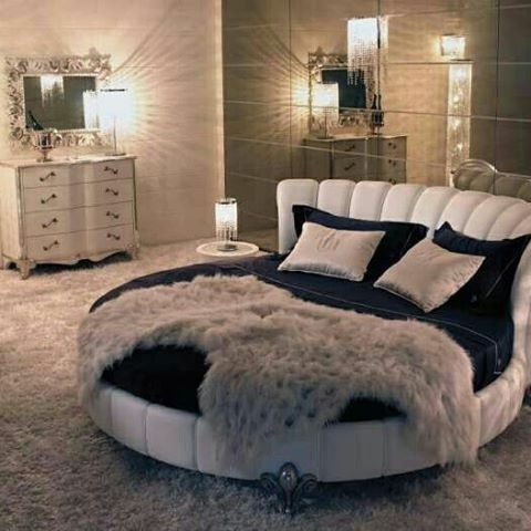Chic bedroom with round bed
