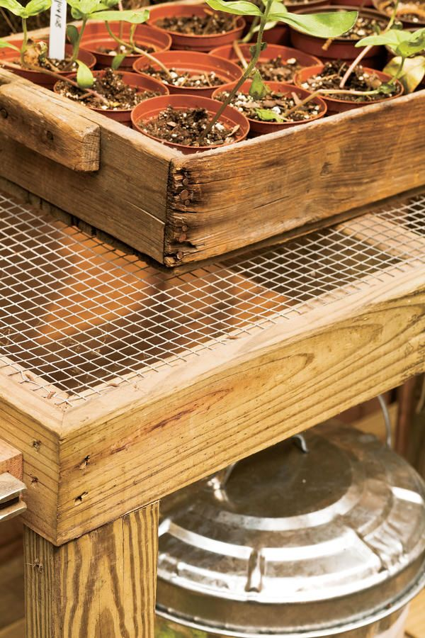 Instant Drainage - Organize Your Garden Shed - Southernliving. Tack hardware cloth atop pressure-treated potting benches for a firm surface that drains immediately with no mess.