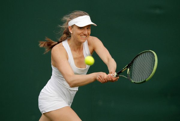 Mona Barthel Photos Photos - Mona Barthel of Germnay plays a backhand shot during the Ladies Singles first round match against Danka Kovinic of Montenegro on day one of the Wimbledon Lawn Tennis Championships at the All England Lawn Tennis and Croquet Club on June 27th, 2016 in London, England. - Day One: The Championships - Wimbledon 2016