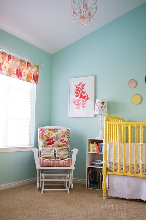 im completely obsessed with this nursery scheme! love the aqua, yellow, and pops of red and pink!