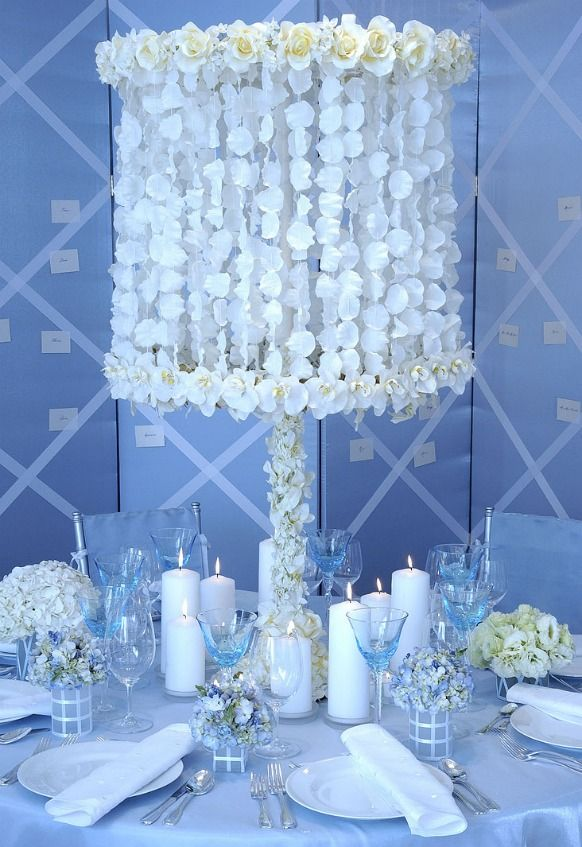 Preston Bailey- This is pretty and could be done inexpensively. Silk flower petals and ribbon.