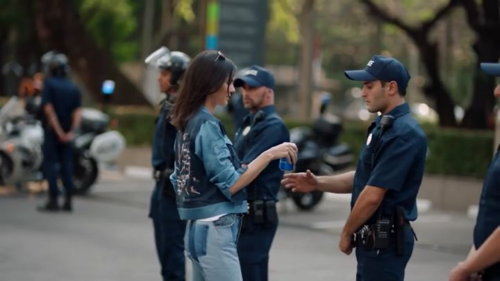 "Pepsi Pulls Controversial Kendall Jenner Ad  Within 24 hours Pepsi has decided to pull its controversial advertisement featuring Kendall Jenner saying the company ""missed the mark"" with the protest-themed ad.  In the ad Jenner is depicted at a photoshoot which she abandons when she notices a protest in the streets outside. She joins the crowds and in one moment that has drawn considerable backlash hands a police officer a can of Pepsi as a means of bridging the gap between the officers and…"