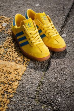 Yellow sneakers of Adidas.