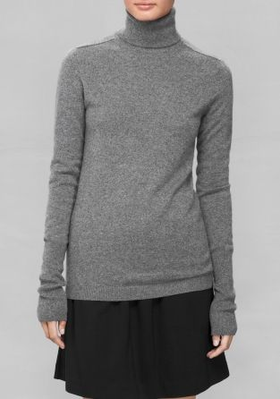 A cozy cashmere sweater featuring a neck-warming turtle neck.