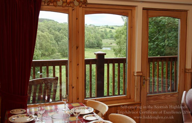 View from Kestrel's. The loch is surrounded by native birch woods full of wildlife and flowers.