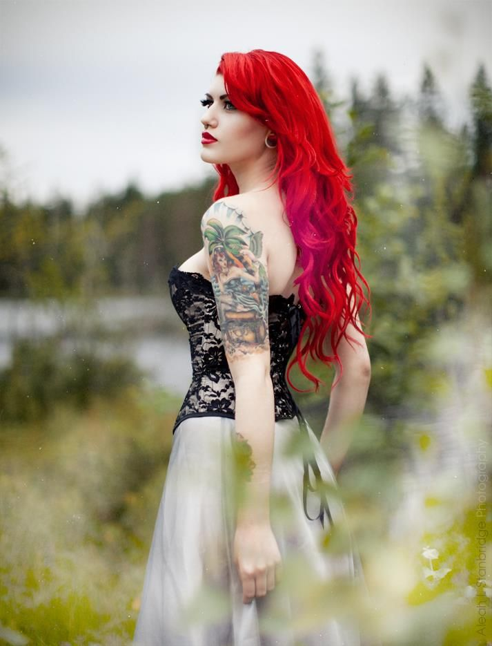 Redhead girls with tattoos