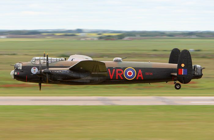 "Taken from the Saskatoon Airport's control tower, we see just how low this Lancaster was. One thing of note here is the dihedral of the wings. On the blue circular nose art, we see a depiction of a Victoria Cross, the medal awarded to Andrew Mynarski. Mynarski was 27 years old and flew with 419 ""Moose"" Squadron, Royal Canadian Air Force during the Second World War when he gave his life attempting to help rescue a trapped crew member. His Victoria Cross was awarded in 1946 as the last such…"