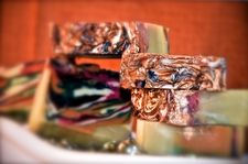 Mysterious Phantoms, Incorporating darks and lights, blues, greens and rich dark black - and with a few slivers of red there, too. I gold gilded it on a whim, resulting in someone turning the lights deep within on high. I sell all my soaps for $1.90 per ounce. I can be reached at:  soapandlather@gmail.com