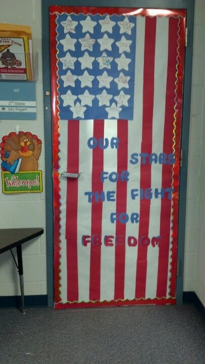 Veterans Day decorated door; use white butcher paper, red crepe paper, stamp white paint on blue paper