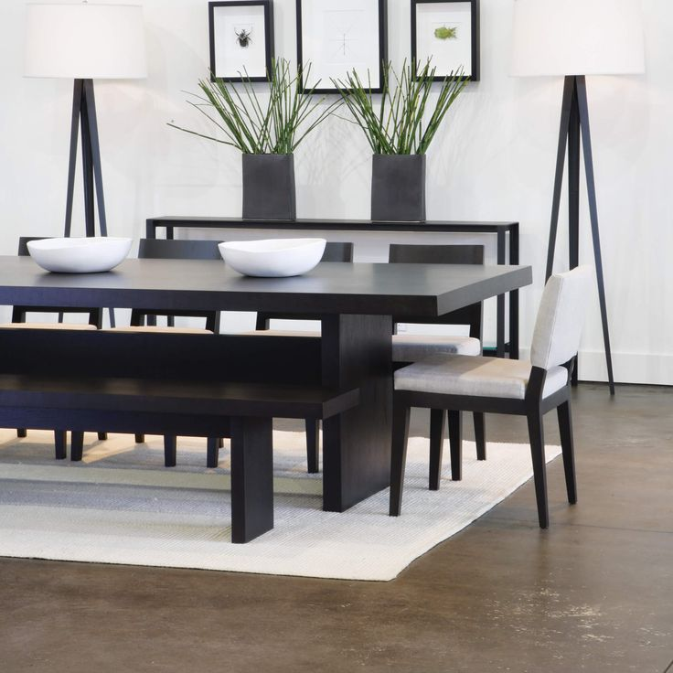 5 piece modern dining room set with bench.  This is a great dining room furniture set for a contemporary home with sleek lines and a trestle style table base.  The table is a walnut veneer construction and the chairs are solid walnut frames.  Measuring 84 inches long, the table can seat eight to ten people.