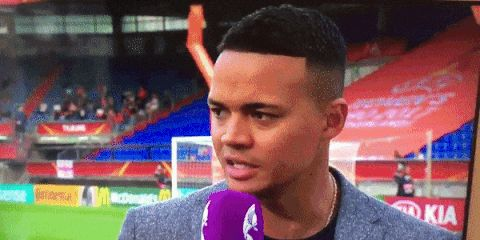 Jermaine Jenas gets soaked by a sprinkler on live TV