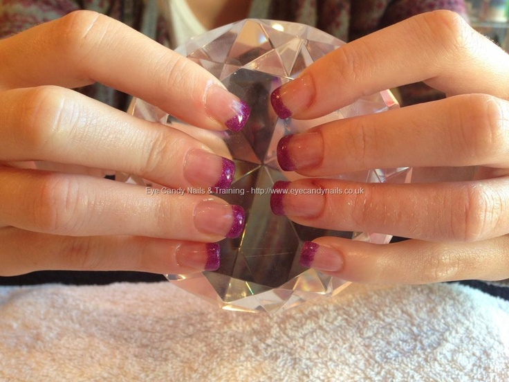 Acrylic nails with purple gel polish on tips