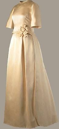 Oleg Cassini  Ivory double-faced silk satin twill by Abraham. Worn by Jacqueline Kennedy to the Inaugural Gala, National Guard Armory, Washington, D.C., January 19, 1961