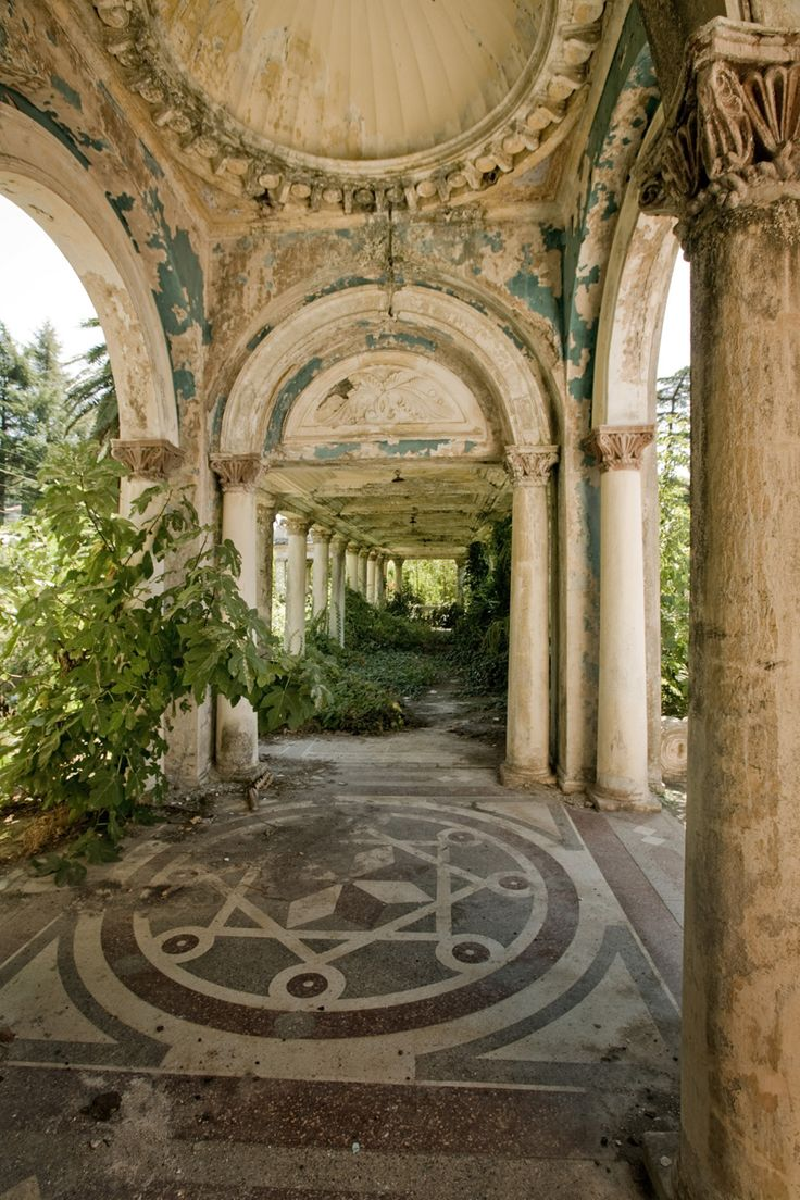 "From the English Russia page: ""This is an abandoned railway station in Abkhazia, former Russian territory. It stays untouched since the collapse of USSR – the railway connection of Abkhazia and Russia stopped and railway station left out of demand so nature could take over the left-overs of Soviet architecture."""