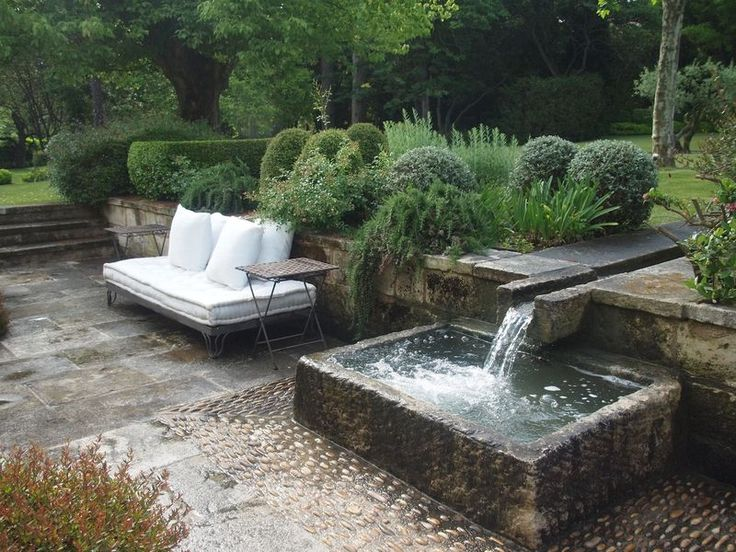 rill into water feature in lovely landscaping