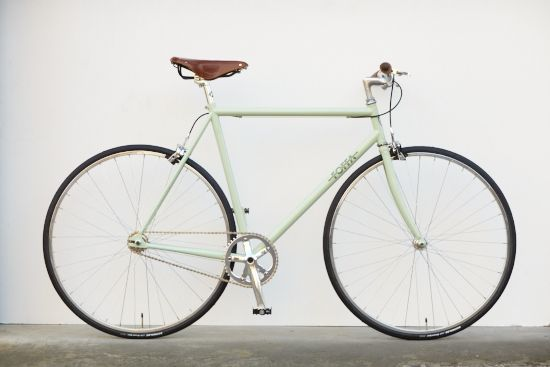 Mint green vintage road bike with brown leather detailing. Add drop handlebars - what a dream.