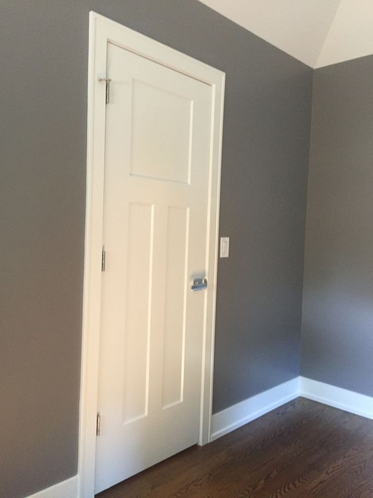 Cinder Paint Color Benjamin Moore.  We love this dark gray.  A perfect dark gray neutral.  We used it in our nursery and boy toddler room too.