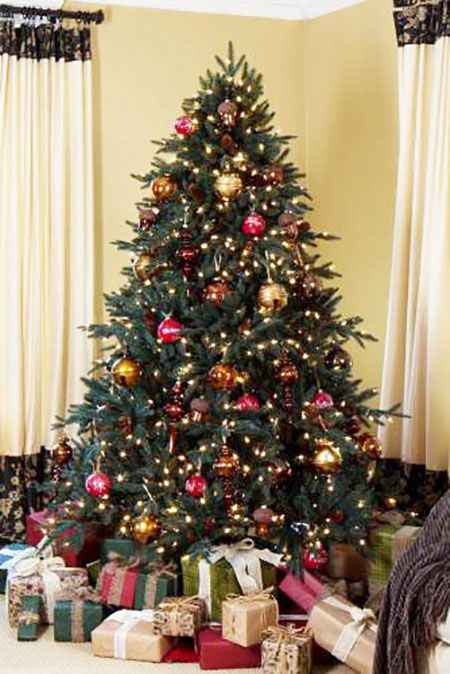 $699 and up  BUY NOW  Take a closer look at the Aspen Silver Fir and you'll see pinecones peeking out between the needles. Realistic tree bark on the trunk also adds to the illusion.