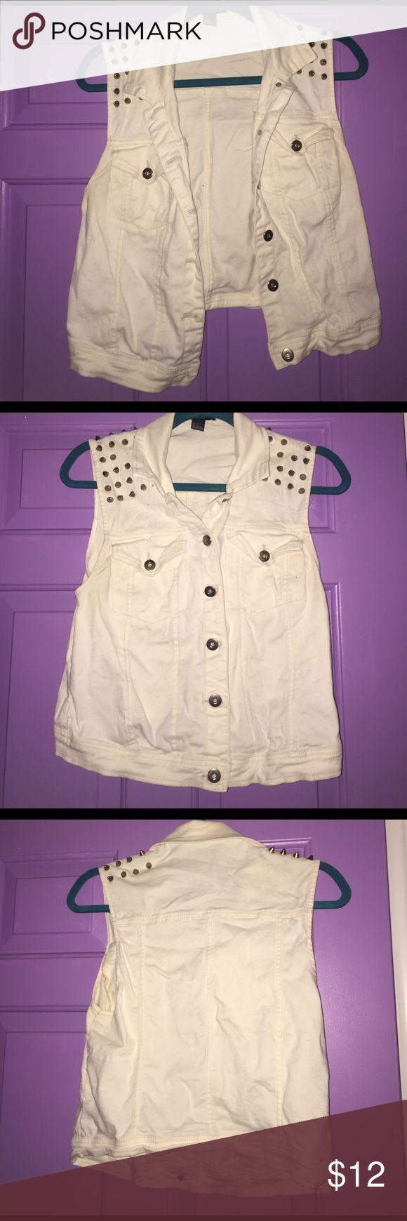 Studded white jean vest This vest has been wore two times at most! It is pure white with gold spike embellishments! A couple of spikes are missing but you can't notice them! It took me 5 minutes of examination to actually see that they are missing. Forever 21 Jackets & Coats Vests
