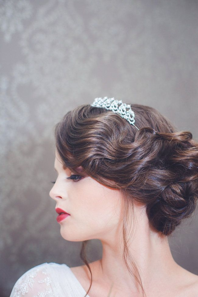 Kristen Peckich, owner of La Pomponnee Salon & Spa in Pittsburgh, styled Mary's hair in a glam, 1920's inspired twist which was pinned to the side. Joy Lager, of beauty by joy, used a strong red lip to draw on the dramatic makeup reminiscent of old Hollywood glamour.  // La Candella Wedding Photography http://www.confettidaydreams.com/speakeasy-wedding/
