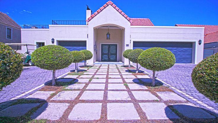 Symmetrically pleasing front garden and entrance.