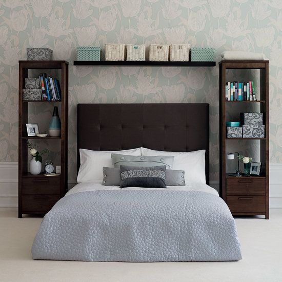The tall bookshelves operate as night stands, only better! And that floating shelf Over the headboard kind of mimics an expensive bridge. I really like the wallpaper, and look at those baseboards peeking from the lower sides: they are some cha-ching $$$ tall baseboards!!