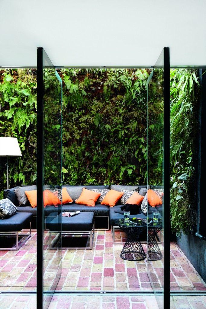 Glass panel doors open to blur the lines between indoor and outdoor living spaces.