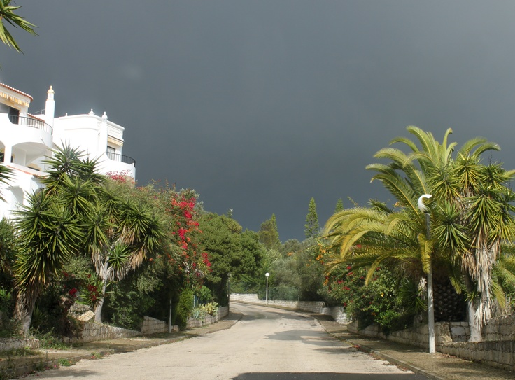 Black skies with bright sunshine in #carvoeiro #algarve  -the strange weather continues
