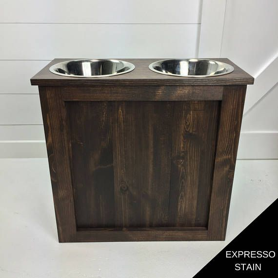 WOODEN DOG AND CAT STAND This wooden dog and cat stand adds the perfect modern farmhouse touch youve been looking for. The stands have a removable top that can be used for storage such as food, treats, or toys. All stands come with two stainless steel bowls. *If you would like a