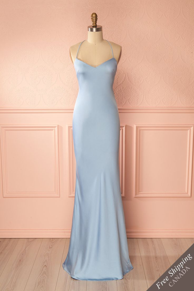 Fabrizzia Sky #Boutique1861 / You will emanate a simple elegance while wearing this pale blue gown. The thin T-style straps are adjustable and showcase your back. The form-fitting cut will show off your silhouette, while the skirt flares as it touches the floor. Adorn yourself with silver jewelry and put on your high heels for a timeless and refined look.