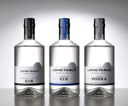 Nice, simple bottles for Long Table Distillery, designed by Saint Bernadine Mission Communications, Inc.
