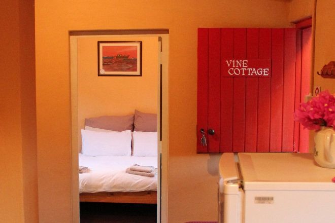 Vine Cottage is the first cottage and sleeps 2 in a double room. The lounge is comfortably furnished with a big sofa and a table and chairs for eating. The kitchen is fully equipped for self-catering and the bathroom has been refurbished with a lovely hot shower and a toilet.