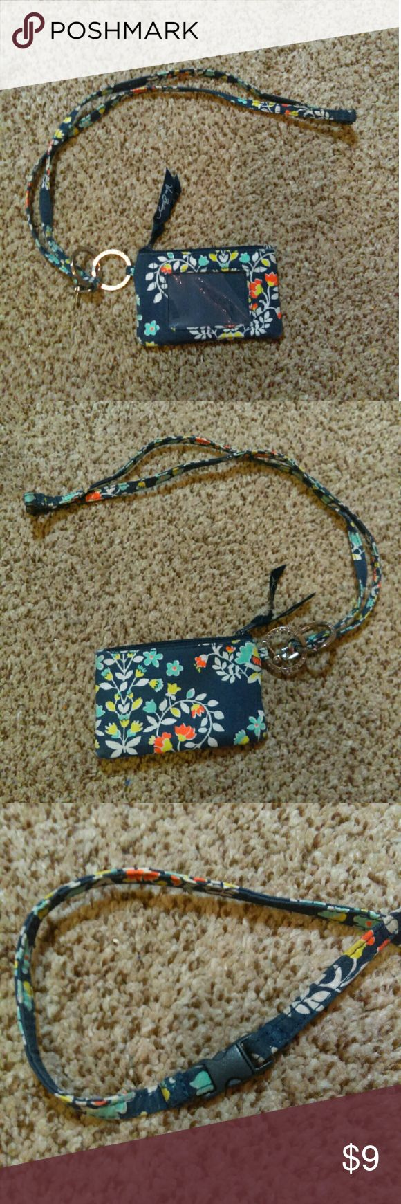 Vera Bradley Id wallet and lanyard Vera Bradley id wallet and lanyard in Chandelier Floral. Lanyard has a safety clip to avoid accidental choking. Lanyard and id wallet both have attached key rings. Beautiful pattern and in great condition except for damaged extra clasp on lanyard shown in last picture. Vera Bradley Bags Wallets
