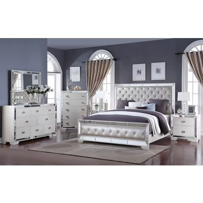 The Gloria 6 pc Queen Bedroom Set from is made with a wooden frame featuring a pearl white finish and a chromed border.