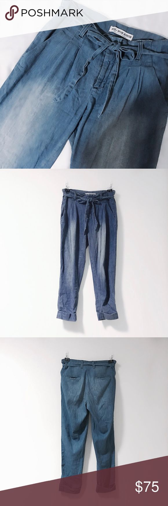 """Kasil + Taylor Jacobson """"Artisan"""" Crop Pant Lightweight chambray jeans by Kasil Collective for Taylor Jacobson. These feature a paperbag pleated waist with tie-front detail and tapered, relaxed fit. Cuffed, cropped hems. Four-pocket construction, triple hook, button, and zip closure. Tuck in a vintage t-shirt and pair with slides. Great condition with light wear. Size 27/US4, fits true to size- 28""""waist, 10""""rise, 24""""inseam. Has light stretch. Vintage-inspired wash. Retail $155 at Revolve…"""