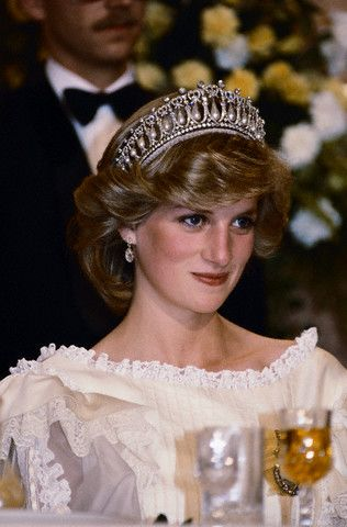 THE QUEEN'S PEAR DROP EARRINGS - These earrings were a loan from QEII.  They are made from the royal family's stones Princess Diana wears Queen Mary's tiara at a dinner banquet. April 29, 1983