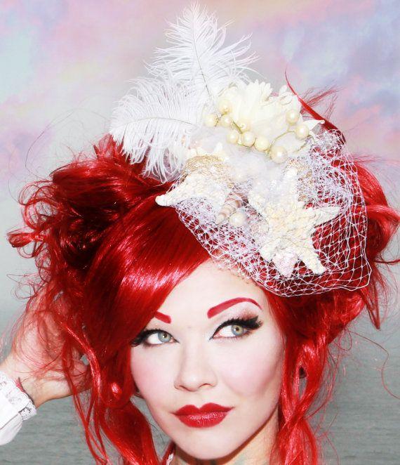 White Nautical fascinator - starfish, sea shells, feathers pearls bride bridal hair accessory. $68.00, via Etsy.