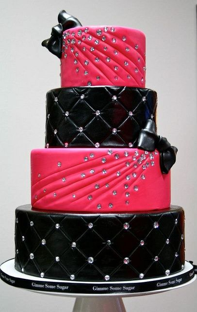 Bright pink and black with crystal detail.  I love this cake except I would do either light blue or purple